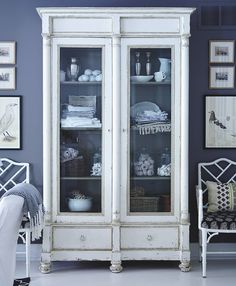 Stylish storage A freestanding antique armoire is a charming alternative to built-in shelves. This one suits the modern bistro style, showcasing the best of both looks. Unlike built-ins, it's an investment piece that will last for years and can be passed down.