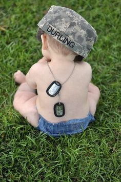 A Baby, dog tags and cap. Military Brat through and through - MilitaryAvenue.com
