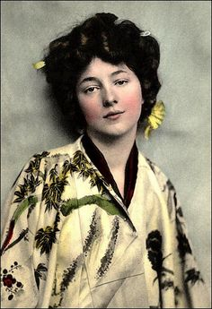 "EVELYN NESBIT as ""GEISHA"" -- The Photo Session That Led to MURDER.  She was the original' ""Gibson Girl"" model of the late Meiji-era, and the darling of photographers. This is an original hand-colored collotype image. The ""Kimono"" (which is actually not a real kimono) is reversed -- right lapel over left, as the photo was originally printed. If this is not a case of the negative being reversed, perhaps she ""incorrectly"" threw it on (or the photographer incorrectly ""adjusted her"" under..."