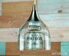 A set includes a hand-cut/polished lens (dimensions: 4.5 x 4.5) made from a recycled 750ml Patron Tequila® bottle and a single-light nickel-finish