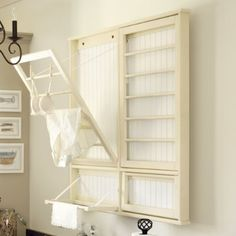 drying rack for front of guest room door that folds up when not in use