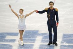 Tatiana Volosozhar and Maxim Trankov of Russia complete their routine in the pairs short program figure skating competition at the Iceberg S...