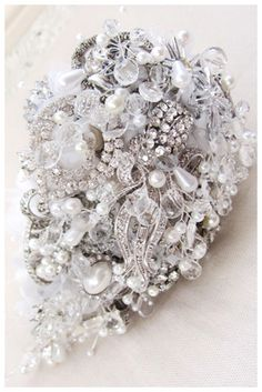 Small Teardrop Shower Brooch Bouquet     These small teardrop shower brooch bouquet designs have a loose, informal style and are packed with vintage jewelry, buttons and pearl and crystal beads. By Debbie Carlisle