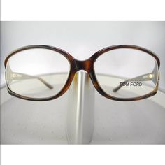 TOM FORD FT5186 052 Brown Havana Eyeglasses STYLE: TOM FORD FT5186  COLOR: BROWN/HAVANA (052)/CLEAR DEMO LENS  ORIGIN: ITALY  SIZE: 55mm X 16mm X 130mm  GENDER: FEMALE  THESE EYEGLASSES ARE 100% AUTHENTIC OR YOUR MONEY BACK GUARANTEED!! THIS WILL COME IN ITS ORIGINAL CASE AND MANUFACTURERS PAPERS. IF YOU HAVE ANY QUESTIONS OR INQUIRIES OF ANY SORT, DON'T HESITATE TO MESSAGE ME. Tom Ford Accessories Glasses