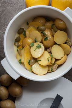 Greek Style Lemon Potatoes // A simple one-pot potato side dish with lemon, garlic and oregano. // @gourmandeinthek