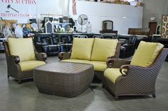 Four piece patio set with two chairs, loveseat and ottoman.