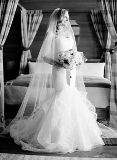 Every bride needs a classic black + white portrait: http://www.stylemepretty.com/2016/06/08/two-pilots-tied-the-knot-with-an-urban-chic-wedding/ | Photography: Jose Villa - http://josevilla.com/