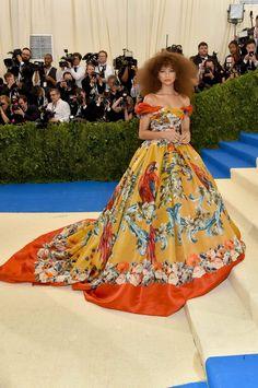 Zendaya wore a Dolce&Gabbana Alta Moda double organza baroque gown in pappagalli carousel print. #MetGala #DGCelebs