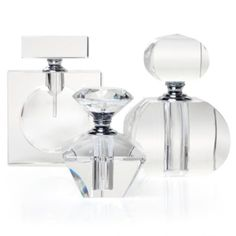 Resurrecting the glamour of pampering, these perfume bottles diffuse sweet aromas and timeless beauty.  Each perfume container upholds geometric elegance with sharp symmetrical shapes carved out of glass crystal that match the form of the bottle's top. These make luxurious presents, as each comes in a sleek black gift box. Sold separately.