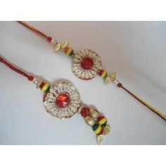 Send this beautiful traditional bhaiya bhabhi rakhi to your brother on this raksha bandhan.Big red stone is there at center and surrounded by white small pearls.    Pack contains:    *One pair of rakhi    *Roli chawal in beautiful pack    *A bar of chocolate    FREE delivery in India.
