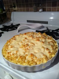 Triple Mac n' Cheese  6 c cooked elbow macaroni  1 pint heavy cream  1/4 c Parmesan cheese  1/2 c Asiago cheese  1/2 c Gorgonzola cheese  2 T. white truffle oil  1 c Mozzarella cheese  Bring cream to a simmer. Remove from heat and stir in the Parmesan, Asiago & Gorgonzola cheese  until smooth. fold in pasta & truffle oil. Spray a baking dish with non-stick spray and fill with mixture, top with Mozzarella and bake at 450 for 8 min or until the cheese begins to brown