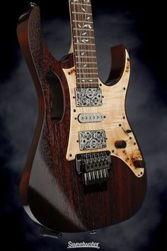 Solidbody Electric Guitar with Mahogany Body, Rosewood Top, Maple Neck, Rosewood Fretboard, 2 Humbucking Pickups, 1 Single-coil Pickup, and Ibanez Tremolo - Charcoal Brown Low Gloss