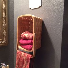 nail a basket to the wall to store hand towels in bathroom. then use handle to hang a towel too. Perfect, i have no towel hanger in the basement and i have this exact basket. Towel Storage, Bathroom Storage, Towel Racks, Basket Storage, Bathroom Organization, Bathroom Ideas, Storage Ideas, Diy Storage, Bathroom Towels