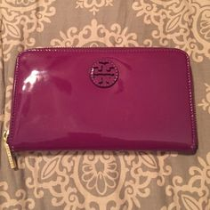 Tory butch wallet Tory birch wallet in deep violet. It has been loved on so there are a couple of scratches that you can only see when the light hits it right. Inside is in perfect condition. Tory Burch Bags Wallets