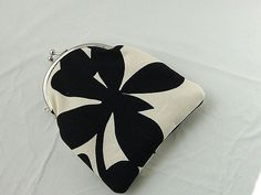 "https://flic.kr/p/7ejPHZ | Mini Delia pouch / coin purse lined in dupioni silk | This attractive black and white mini pouch / coin purse has a timeless floral pattern made from home decorator weight fabric. The inside of the bag with red dupioni to give the purse a rich and luscious touch.  This coin purse is large enough to fit your money, credit cards and jewelry items.  Features: * 100% heavy cotton outer fabric * 100% Dupioni silk lining in red *Curved metal frame is 3.75"" x 2""..."