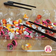 fall fine motor activities - eraser sorting with training chop sticks Seven fun and exciting ways to work on fine motor skills this fall.  Halloween themed fine motor activity ideas for preschool,pre-k, kindergarten, tot school, and early childhood education.
