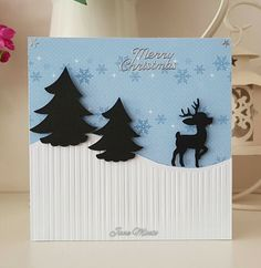 a Christmas card using part of 'that folder' 3 in 1 all occasion embossing folder. The trees and deer are SVG cut files from KaDoodle Bug Designs.