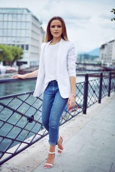 Get more mileage out of your blazers by wearing them outside the office with easy-wearing separates. Kristina of Kayture pulls off that effortless, casual vibe by wearing her white blazer with a pair of relaxed boyfriend jeans and a matching white tee.