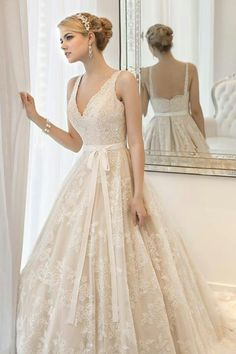 Love this classic dress. Wish I could wear a brides gown to work everyday.  Just beautiful