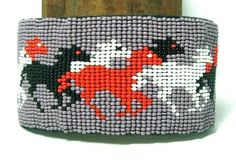 Beaded cuff bracelet with multi colored running horses. Leather backed & adjustable.  Just 16.95 w/ free shipping w/in the USA #horses #beadwork #bracelet