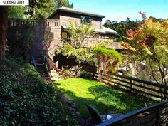7330 Woodrow Drive, OAKLAND, CA 94611 - $879,000 / beds: 4 / baths: 2 Full,1 Partial - Elegant traditional w/ expansive decks on .29 acres w/ terraced landscaped yard, large lawn, play structure and gardens. Open floor plan w/ formal family, living & dining rooms. Vaulted wood beamed cielings & gorgeous wood details. Sunny Eat-in Kit. Large master w/Jacuzzi Tub, Private Deck & Walk in