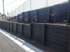 Days Road, Coomera - Charcoal Timber Look Concrete Sleepers & Charcoal Concrete Posts (sealed after construction)
