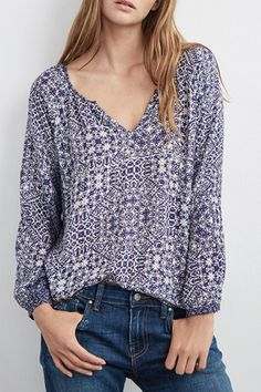 Beautiful boho print popover blouse in this Moroccan inspired design is soft and comfortable. With its lovely drape and subtle bell sleeves this blouse looks so feminine. loose fit intended. Hand wash.   Boho Blouse by Velvet. Clothing - Tops - Long Sleeve Clothing - Tops - Blouses & Shirts Canada