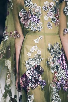 Machine embroider the flowers separately onto sheer. Then attach.   Valentino