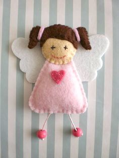 Little felt angel. No tutorial. Just a picture. Looks like it would be simple enough to duplicate. And very adorable!
