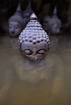 Bangkok, Thailand: partially submerged Buddha statues at the amulet market near Chao Phraya river - Narong Sangnak/EPA