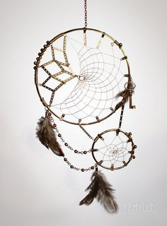 Large 14 inch Buckskin Dream Catcher. Black bone beads on the outer edge of the web, black and blue glass crow beads hang in between, and on the leather hangings. Onyx and Lapis Lazuli chips spiral...