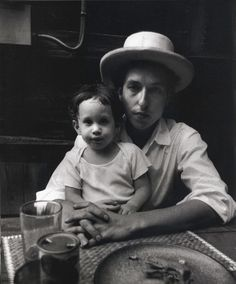 Bob Dylan holding his son Jesse    photographed by Elliott Landy, 1968