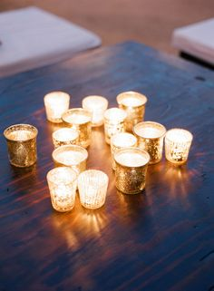 warm up the evening with glowing mercury glass votives.