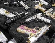 Pimp my shooter: The amazing bling guns that belong to Mexico's drug lords