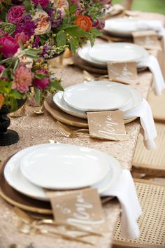 Style me pretty Surprise party. White plates with West Elm Wood Slice Charger, Gold Rimmed White China, gold sequin table cloth. Bright flowers in black urns and gold candle votives. Al Fresco Dinner, Sequin Tablecloth, Tablecloths, Thanksgiving Table, Christmas Tables, Holiday Tables, Cake Table, Decoration Table, Tablescapes