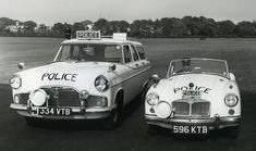 Lancashire Constabulary police cars of the early 1960s. At this time much of what is now the Greater Manchester Police's area was part of region covered by Lancashire Constabulary. Shown in the recently introduced all white livery is a Ford Zephyr Farnham estate vehicle and an MGA sports car.  From the collection of the Greater Manchester Police Museum and Archives. For more information about the Force Museum please visit our website. www.gmp.police.uk