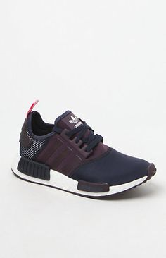 Online Only! adidas combines modern streetwear style with innovative technology in the Women's NMD_R1 Multicolor Low-Top Sneakers. Fashioned in a multicolored print, these low-top sneakers feature a neoprene and mesh upper, durable and shock-resistant angled boost™ midsole with built-in EVA plugs, and bold archival details.   boost™'s energy-returning properties keep every step charged with an endless supply of light, fast energy Neoprene and mesh upper Overlock deco stitching...