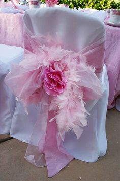 Covered Chairs for reception or even wedding seating along aisle - Pink, Big Flower, Feathers . . . Cute