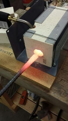 Homemade forge/furnace made from 2 firebrick and a map gas propane torch