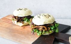 <p>Steamed bao buns are stuffed with oyster mushrooms marinated in an umami sauce and paired with steamed kale and caramelized onions. </p>