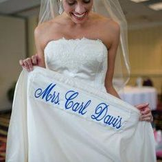 Surprise him with your new name in blue on the hem of your dress.