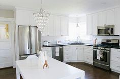 white cabinets / dark counters / silver hardware