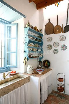 In a charming corner of the Town of Patmos island, called Malandraki, a unique residence, with great history, towers majestically. Rustic Kitchen, Country Kitchen, Kitchen Decor, Greek Decor, Sweet Home, Cottage Interiors, Küchen Design, Style At Home, Home Fashion
