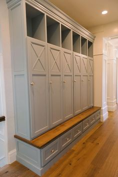 Closed doors to hide coats and sliding drawers for shoes or hats/gloves with a small bench for sitting.