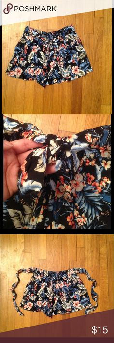 "Floral printed short Black short with floral print. Self fabric belt attached to short. Elastic back waist. Front pockets. 1 3/4"" inseam. 100% Rayon. Brand new, no tags Papaya Shorts"