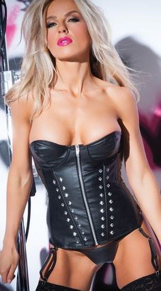 85ba6093a11 This faux leather studded corset features a sweetheart neckline