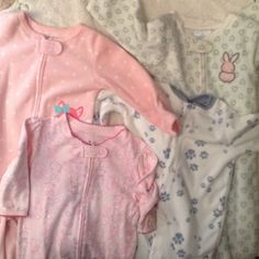 Baby pj bundle 3-6 and 6-9 months 4 gently used footie pijamas. 3 are fleece and the other is cotton. Super cute and comfortable. Unfortunately my daughter is too big for them so she won't be needing them anymore. Please feel free to make me an offer Intimates & Sleepwear Pajamas