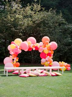DIY balloon arch in pinks and yellow
