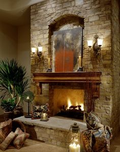 This elegant fireplace is unique in that it has two sconces…