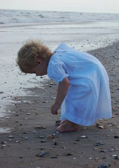 She finds sea shells by the sea shore.